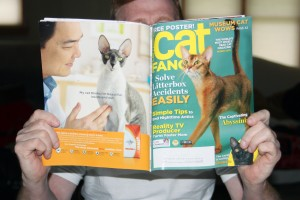 Paul reading Cat Fancy