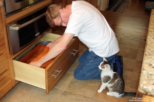 Paul and Annie cleaning drawers
