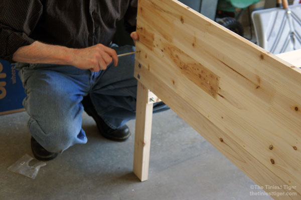 Paul assembling garden table